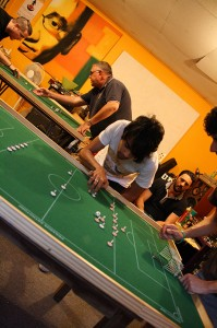 Gordy attacks Fabrizio in the foreground while the two Steve's battle it out in midfield on Table One.