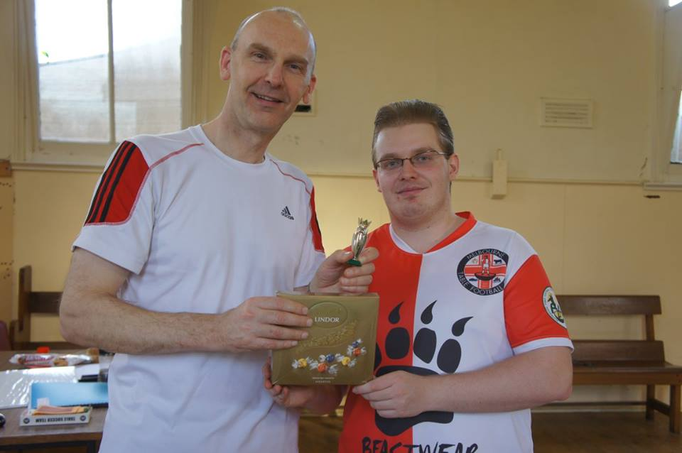 Carl receives his winners prize from newly re-elected club president Luke Radziminski