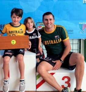 Raffaele with his two sons, Gabriel (l) and Taylor (r) on the dias at the recent World Cup in Italy.