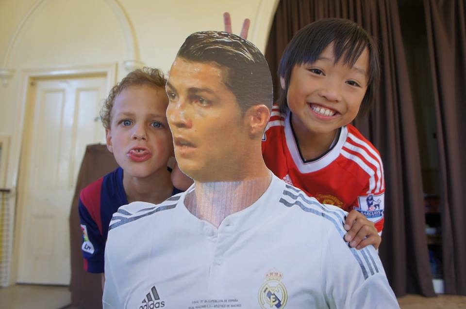 Aidan and Benjamin having fun with MTFC's newest member- Cardboard Ronaldo!