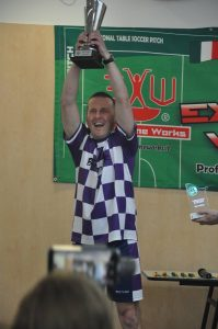 Open winner Rob Green proudly raising hit title.