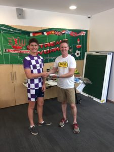 ATFA President Adrian Connolly presenting Jonty Brenner with his Junior title