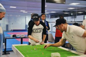 Adrian Connolly taking on Melbourne City FC captain Scott Jamieson in an Anzac Eve exhibition table football match to raise awareness for testicular cancer.